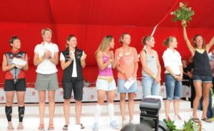 Coach Cindy shares the podium with some of Ironman's iconic pros.